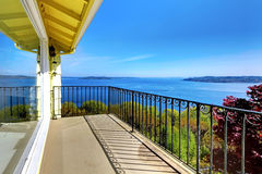 House balcony with water amazing view and metal railings. Stock Photography