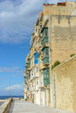 House with balconys on Malta at seaside. In summer Stock Images