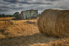 House, bales and field. stock photo