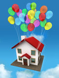House with balloon. House with balloon in the sky and clouds Royalty Free Stock Image
