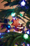 House, balls, stars and lighting garland on Christmas tree Stock Photo