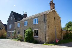 House, Bampton Village, England. A house in Bampton Village, England. The picturesque village is often used in filming and perhaps most famous globally for its Stock Photos