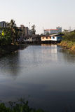 House beside a Bangkok canal. In the evening Stock Image