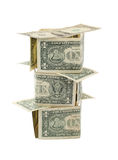 House from bank-notes. High-rise house made from dollars on white background Royalty Free Stock Images
