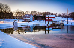 House and barn reflecting in a semi-frozen pond in rural York Co Royalty Free Stock Photography