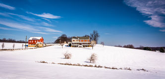 House and barn on snow covered farm fields in rural Carroll Coun Stock Photography