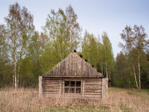 House with a barn standing on the field Stock Photography
