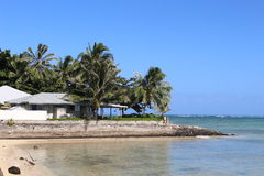 House at the beach. House at the edge of water, tropical beach, Hawaii Stock Images