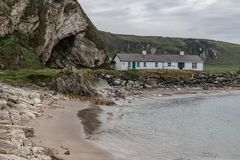 House, Beach and rocks in Ballintoy Harbour. Moyle, Northern Ireland, UK royalty free stock photos