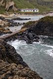 House, Beach and rocks in Ballintoy Harbour. Moyle, Northern Ireland, UK royalty free stock photo
