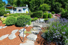 House with beautiful curb appeal and outdoor rest area. Port Orc. House with beautiful front yard landscape. and outdoor rest area with chair. Port Orchard town Royalty Free Stock Photography