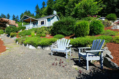 House with beautiful curb appeal and outdoor rest area. Port Orc Royalty Free Stock Photography