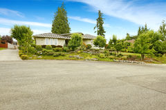 House with beautiful front yard landscape design Stock Photo