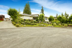 House with beautiful front yard landscape design Royalty Free Stock Image