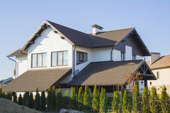 house with beautiful iron fence and car parking royalty free stock photography