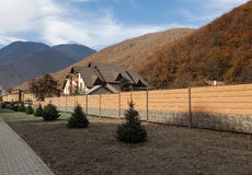 House behind a fence in the mountains Stock Photography