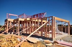 House being built. A new wooden framed house under construction royalty free stock images