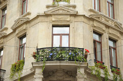 House in Belgium. Balcony decorated with flowers on corner of house Stock Image
