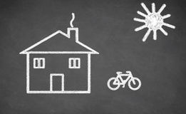 House and bicycle drawn on chalkboard. Royalty Free Stock Photo