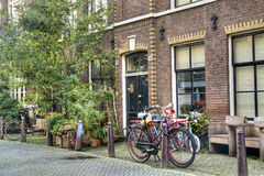 House with bicycles in Amsterdam Stock Images
