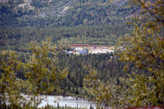 House in big forest. Small wooden houses in big green fir forest Royalty Free Stock Photography