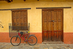 House with bike in front Royalty Free Stock Photo