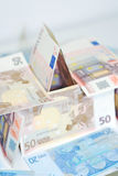 House of bills. A house made from a selection of euro dollar bills Royalty Free Stock Images