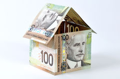 House of bills. Concept of money to own or build a home Stock Photos