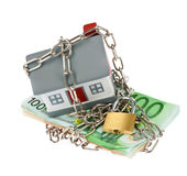 House with bills, chain and padlock Stock Photo