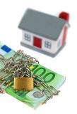 House with bills, chain and padlock Royalty Free Stock Photo