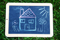A house on a blackboard Stock Photo