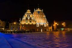 House of the Blackheads at night in Riga, Latvia royalty free stock photography