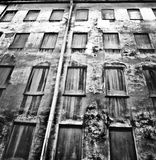 House with the blind windows. And the shape of a face made of dirth Royalty Free Stock Photos