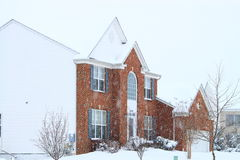 House in Blizzard. Red brick house in winter Blizzard Stock Photo