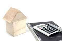 House of blocks, a calculator. Stock Photos