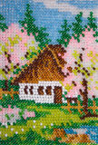 House in the blooming garden. Beadwork: house in the blooming garden Royalty Free Stock Photos