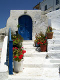 House with blue door on Santorini Stock Image