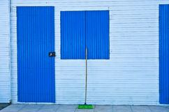 House with blue doors and shutters Stock Photos