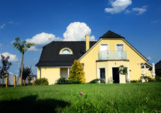 House with blue heaven Stock Images