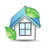 House with a blue roof and green leaf.  Royalty Free Stock Images