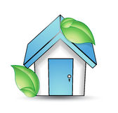 House with a blue roof and green leaf Royalty Free Stock Photography