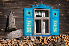 House with blue shutters. Old wooden house in the country with blue shutters Royalty Free Stock Image
