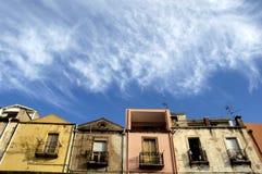 House and blue sky. Row of building under a cloudly blue sky Stock Photos