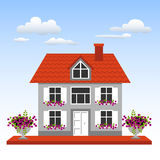 House on a blue sky background. Landscape with house, flowers and clouds on a blue sky background. Vector illustration Stock Photos