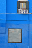 House with blue wall Stock Photo