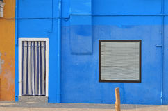 House with Blue Wall Stock Image