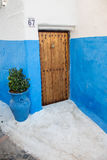 House with blue walls and wooden door Stock Image
