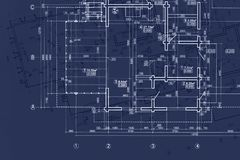 house blueprint on architects desk, engineering drawings and plans on blue background