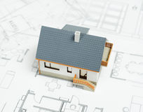 House on blueprint Stock Photos