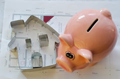 House Blueprint with Room Names in German and Piggy Bank Stock Images